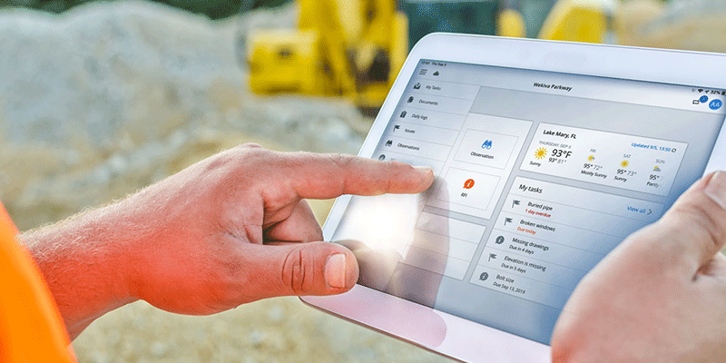 person using ipad in field